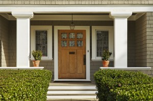 Greenery, doors and hardware make the entry way pop